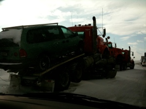 Yes that is a total of four (one is hiding) tow trucks to get one car.
